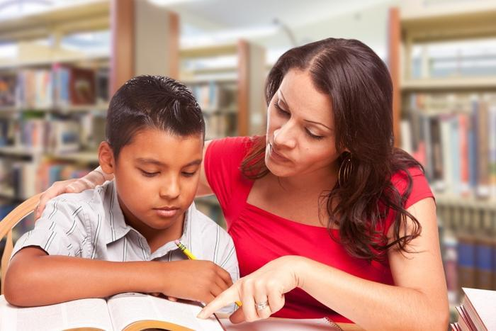 children reading with parents
